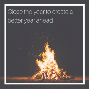 Image of a bonfire at night with the caption: close the year to create a better year ahead.